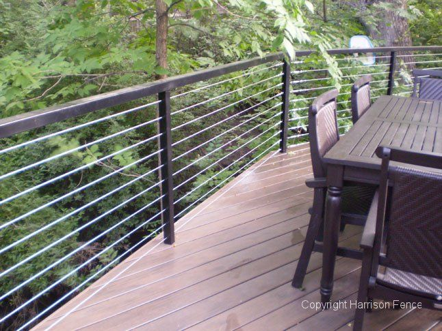 Composite deck floor with cable wiring railings