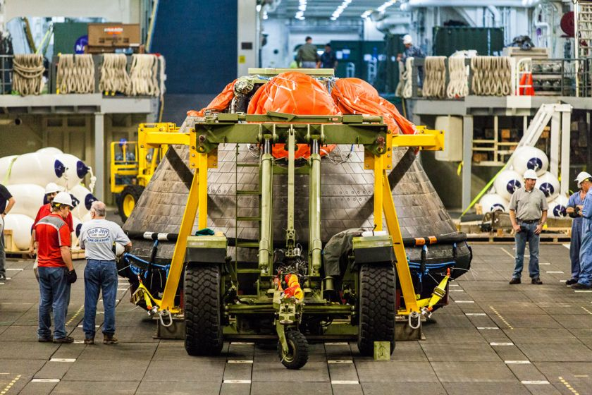 NASA's Orion spacecraft sits in the well deck of the USS Anchorage prior to its offloading at Naval Base San Diego. 2015.  Ph. by Kevin Baird