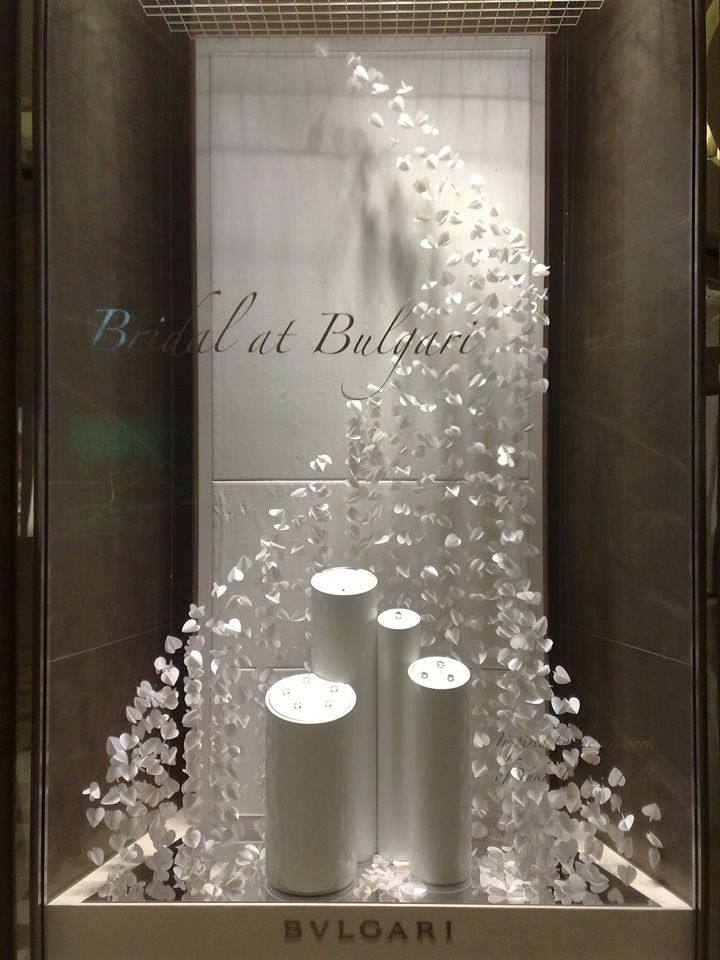 3d hears suspended in a wave patter for jewelry window for Show window designs