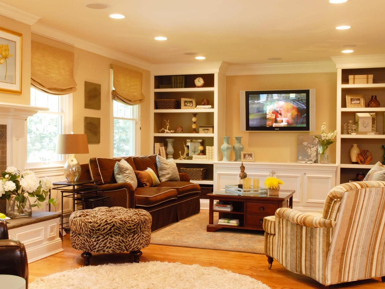 Built in cabinets contemporary living room lucy and company - A Built In Bookcase Is A Great Focal Element To Any Space In This Transitional Living Room Two Built In Units Flank The Wall Mounted Tv