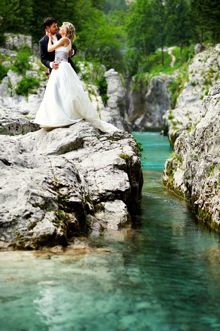 Bride and groom at gorgeous turquoise river Soca, wedding at