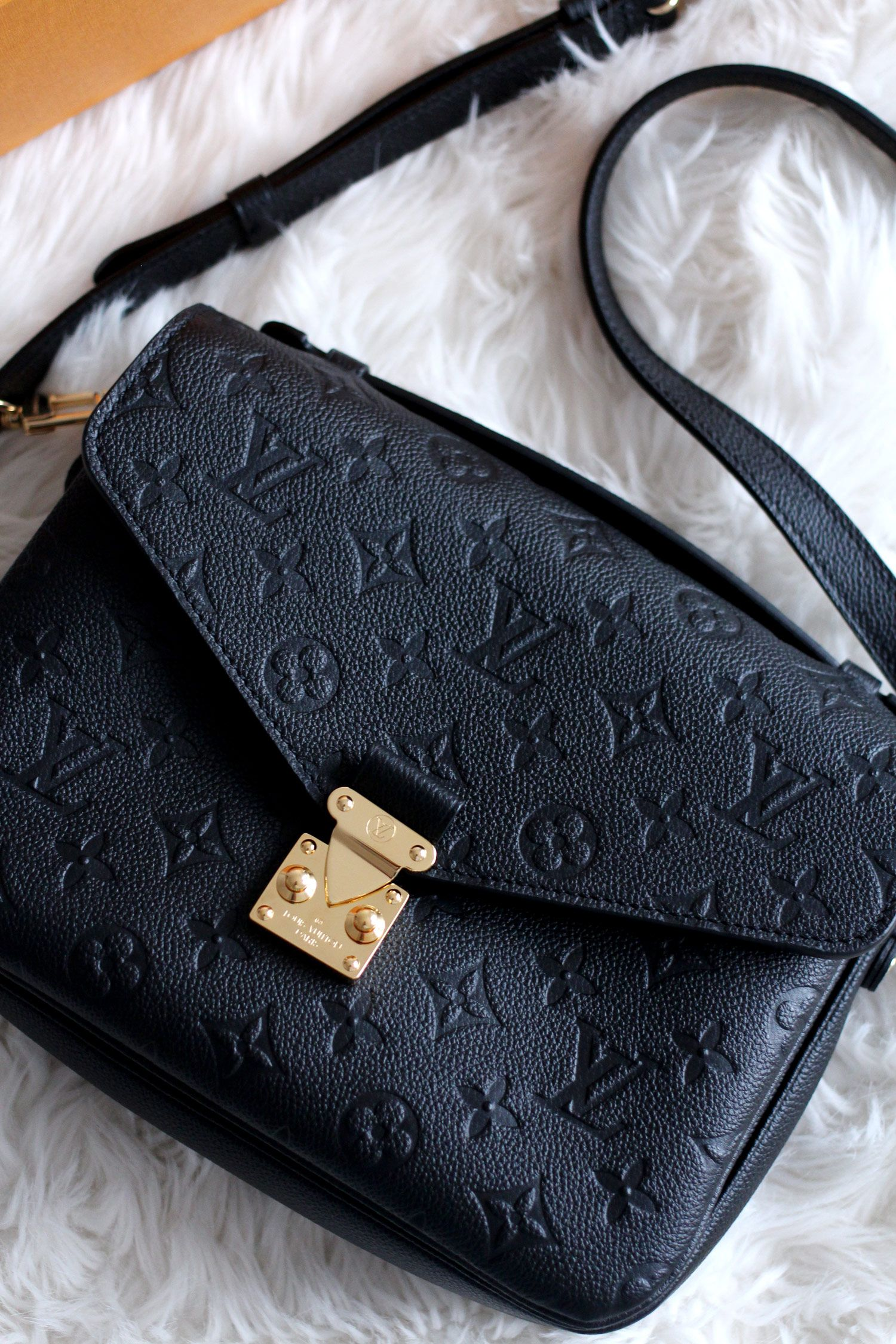 be2fb391e The Louis Vuitton Pochette Metis in black monogram empreinte leather with  gold hardware - review and