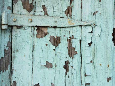 Close Up Of Weathered Metal Door Hinge With Paint Peeling