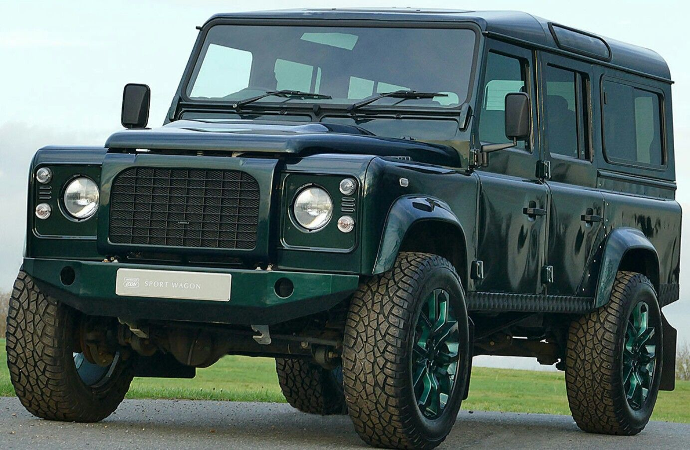 Green Land Rover defender Sport wagon Land rover