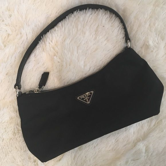 d849768cb40ef6 NWOT Prada Nylon Pouchette/Baguette Bag Never worn. Excellent condition.  Nylon body with leather strap and silver logo. Prada Bags Shoulder Bags