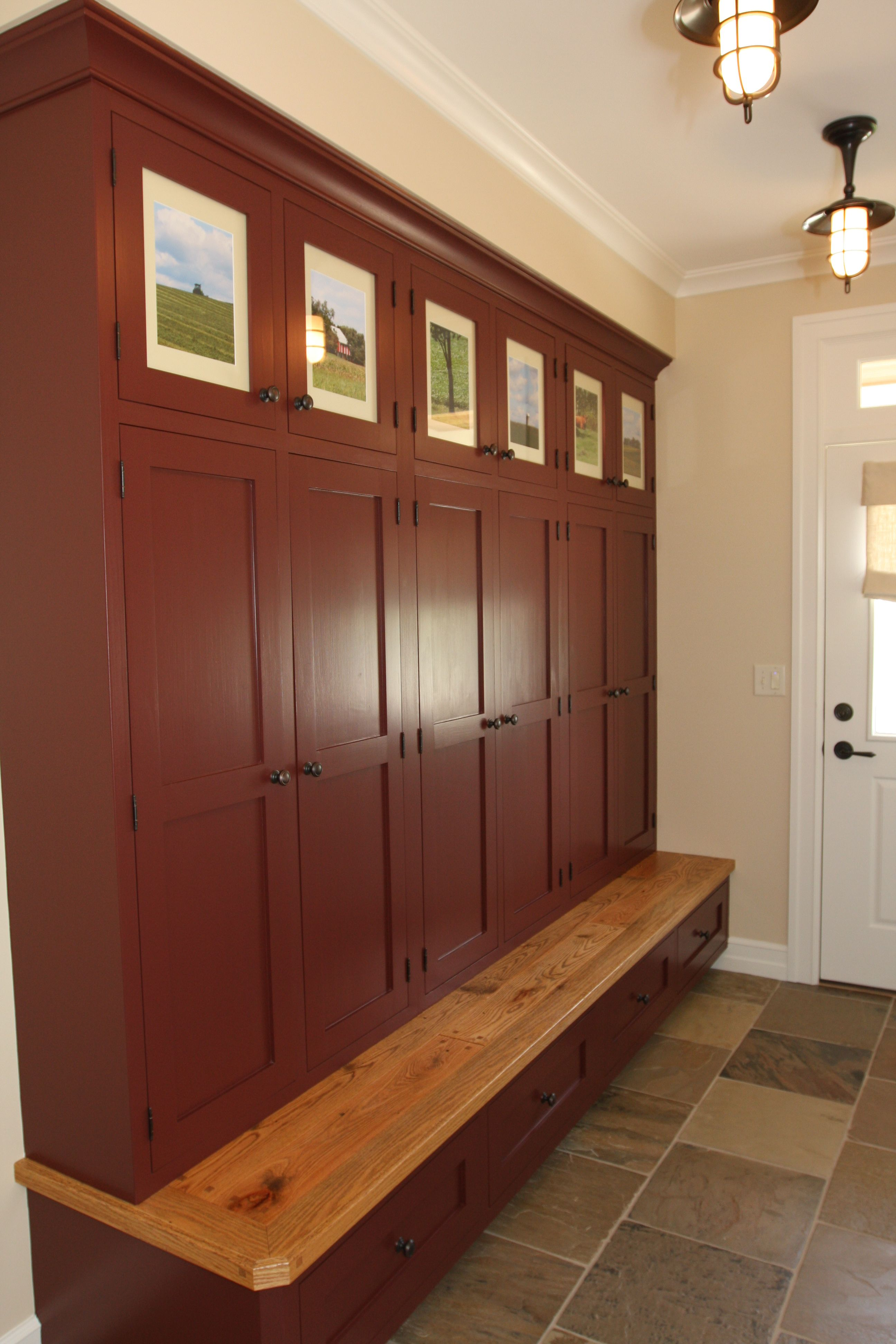 Maroon cubbies with built in bench for mud room entry way storange