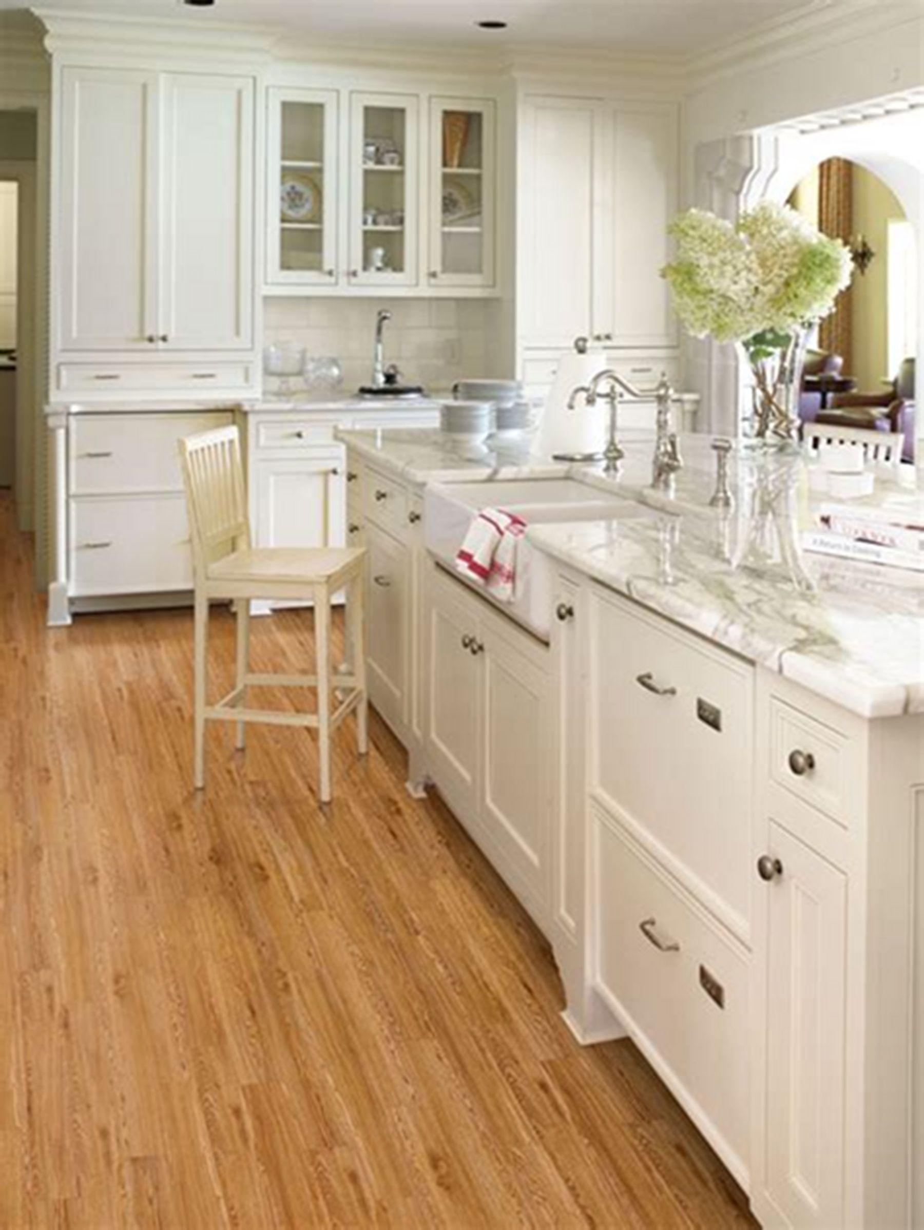 10 Amazing Kitchen Designs To Inspire Your Comfortable Kitchen White Wood Kitchens Kitchen Flooring White Kitchen Lighting