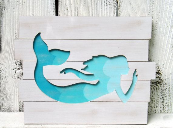 Mermaid Sign~Wood Mermaid~Aqua~Nautical~Beach House~Mermaid Decor #mermaidsign Wood Planked mermaid Sign with gorgeous aqua blues outlining the silhouette of the mermaid. Wood has a white wash finish. Built in key hole hanger on the back Measures 19 Wide x 14 1/2 Tall #mermaidsign