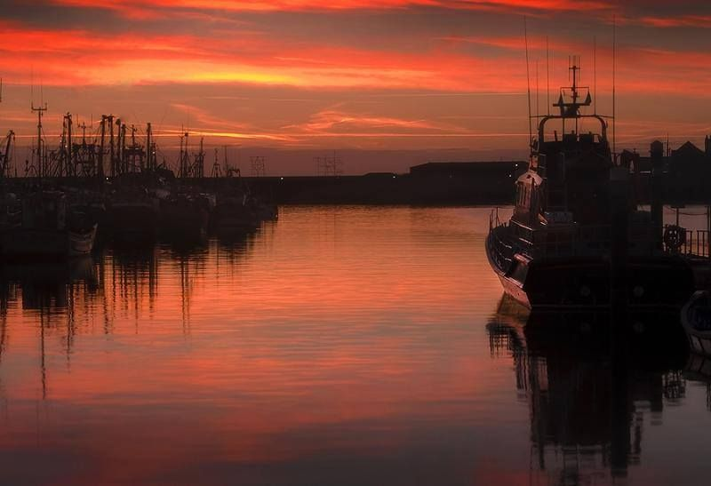 Sunrise in the harbour at Newlyn in west Cornwall, a stunning photo by Barrie Tumbridge Photography.