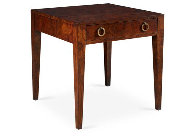 A sleek side table with traditional and midcentury style influences.