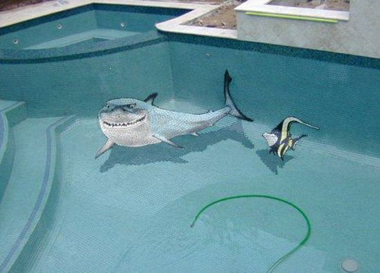 Swimming pool tile work shark and fish on bottom of for Raising fish in a swimming pool