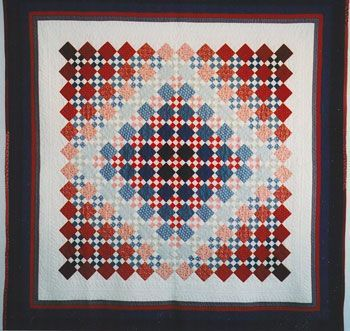 "Shaded nine patch quilt, 51 x 51"", shown in patriotic red, white and blue. Pattern by Barbara Dieges"