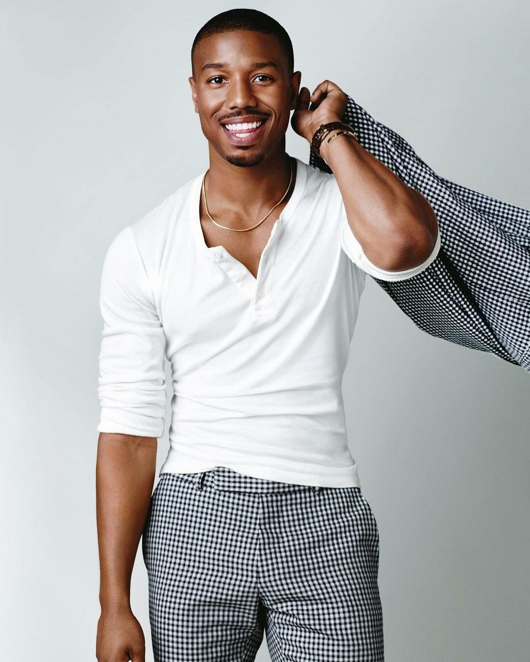00fb68c217c7 Michael B. Jordan showing off his sense of style with a deep white henley