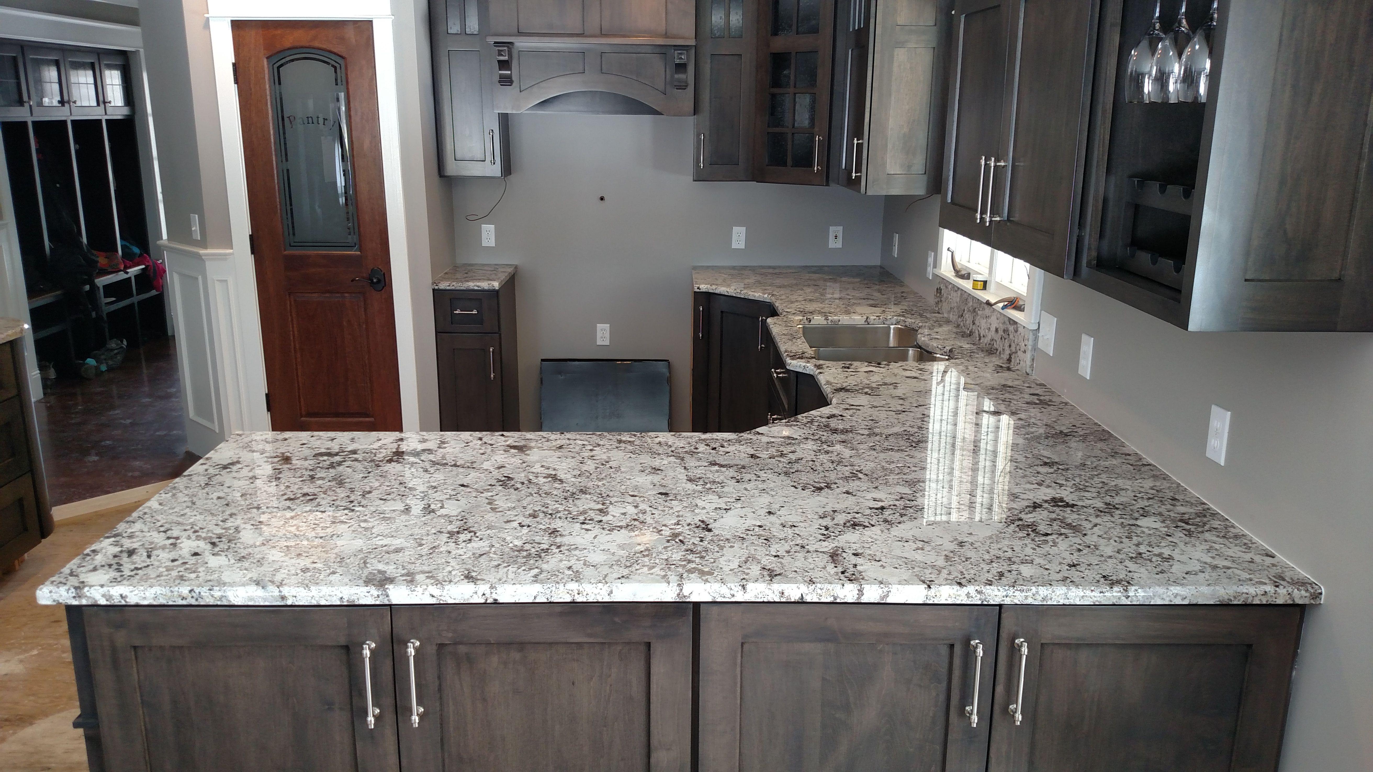 Alaska White Granite Looks Amazing Paired With Espresso Cabinets