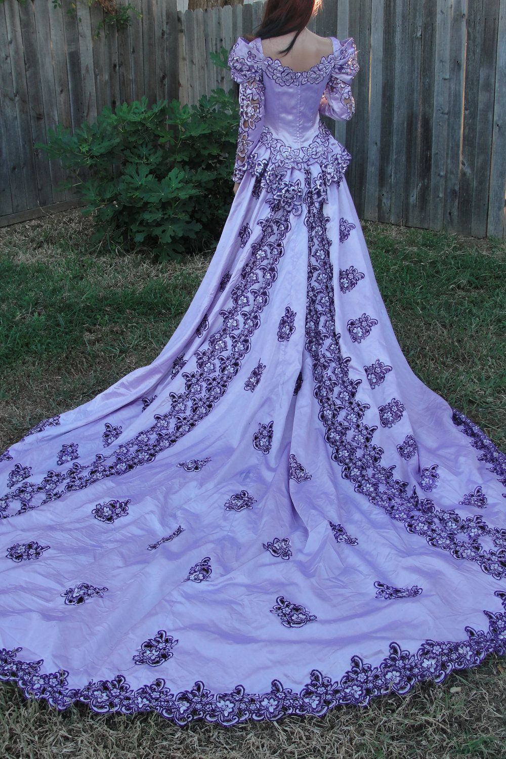 Purple gothic hand dyed wedding gown with cut out detail and ...