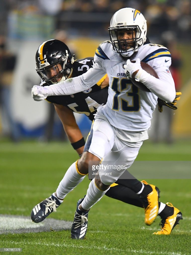 Keenan Allen Of The Los Angeles Chargers Runs Upfield After A Catch Los Angeles Chargers Nfl Football Art Football Outfits