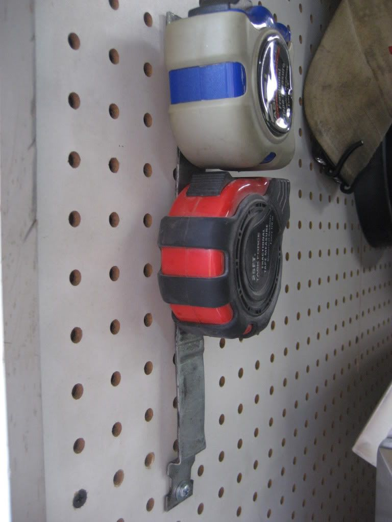 tape measure holder garage workshop garage work bench on cool diy garage organization ideas 7 measure guide on garage organization id=32624
