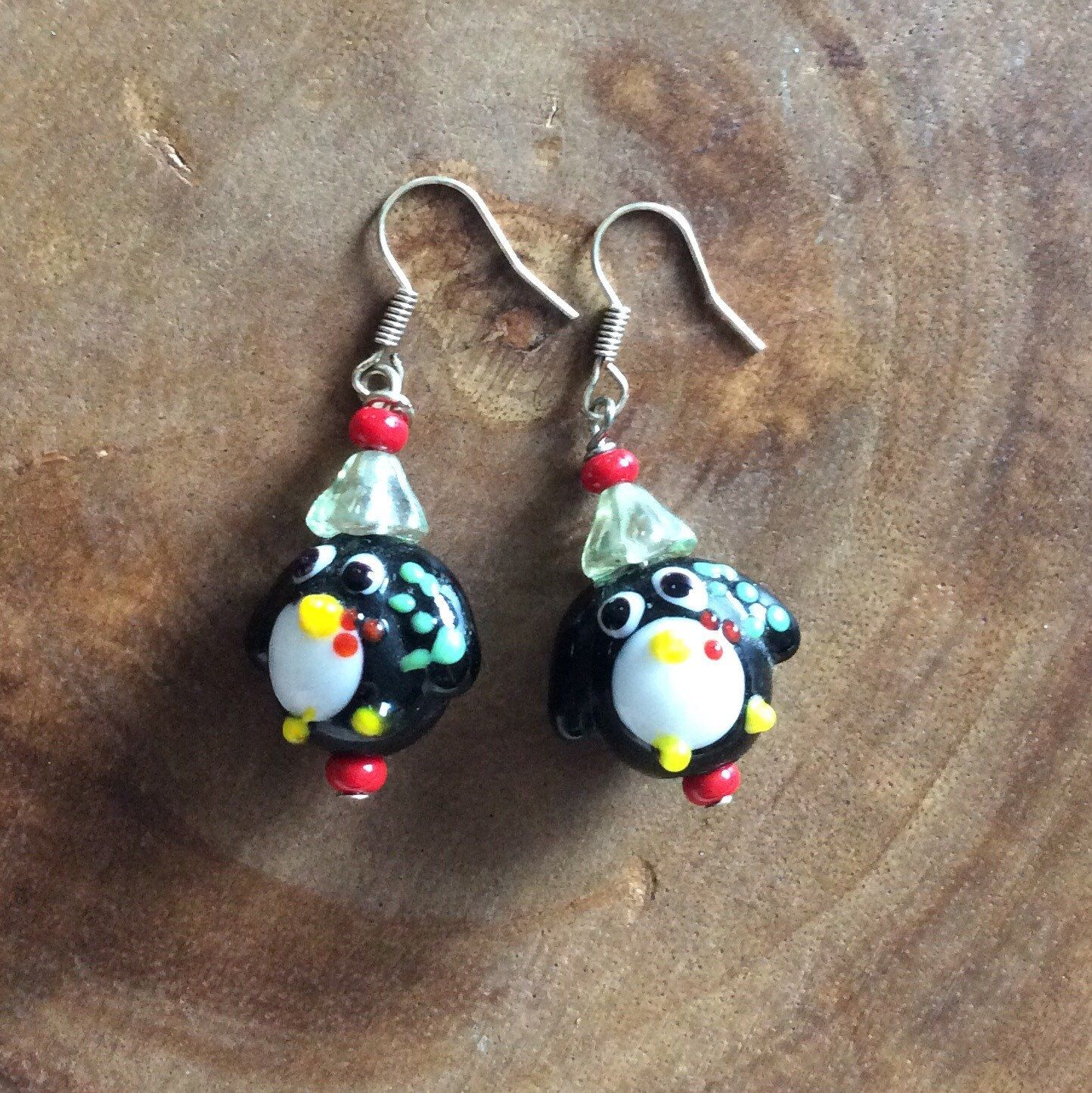 A personal favorite from my Etsy shop https://www.etsy.com/listing/452858538/christmas-earrings-penguin-earrings