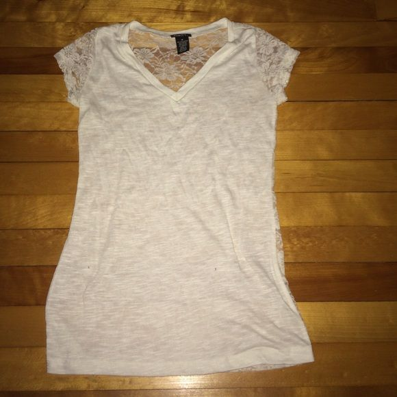 white v neck t-shirt with lace on back worn couple times, good condition Rue 21 Tops Tees - Short Sleeve