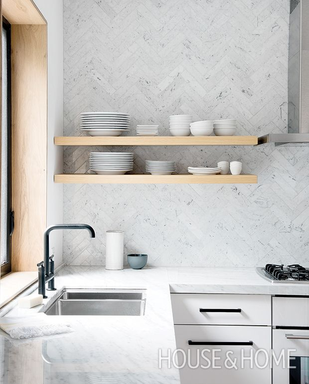 Simple floating shelves in a light blonde wood set right near the sink and stove makeplating food simple and quick.   Photographer: Alex Lukey   Designer: Sam Sacks