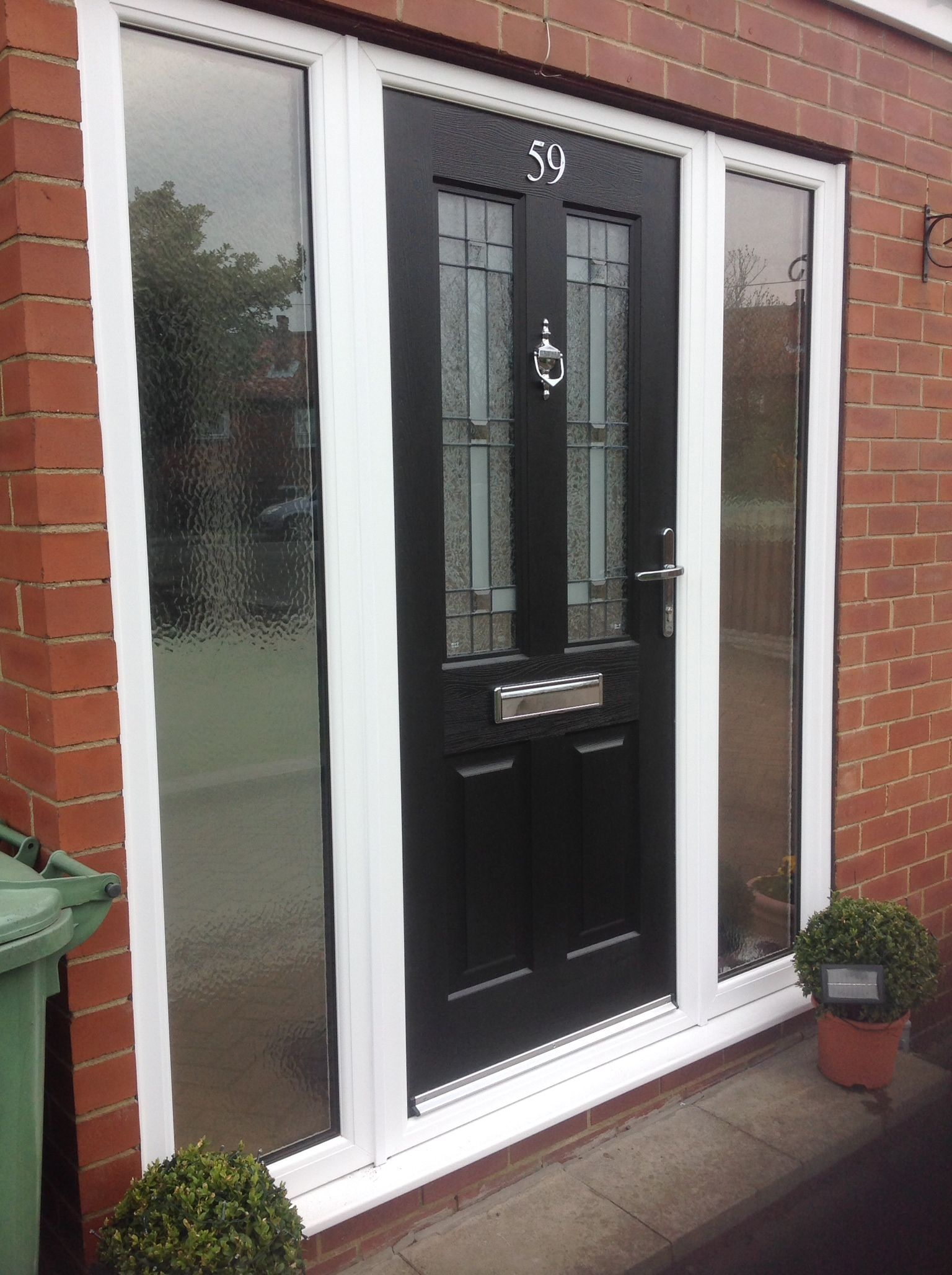 front door side panels glass. composite door with glass side panels white frame, in black chrome trim. call front e