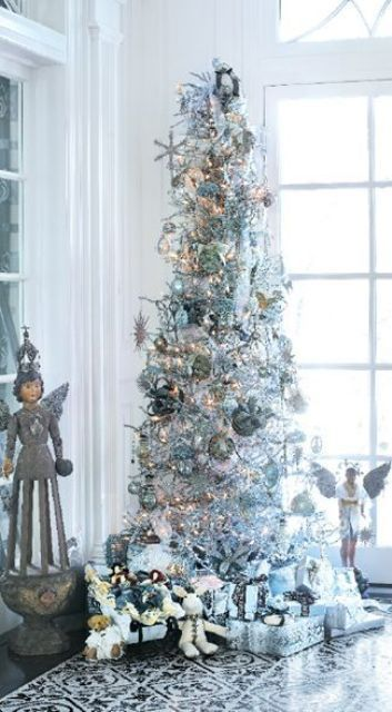 a silver tree with metallic ornaments Christmas Pinterest - white christmas tree decorations