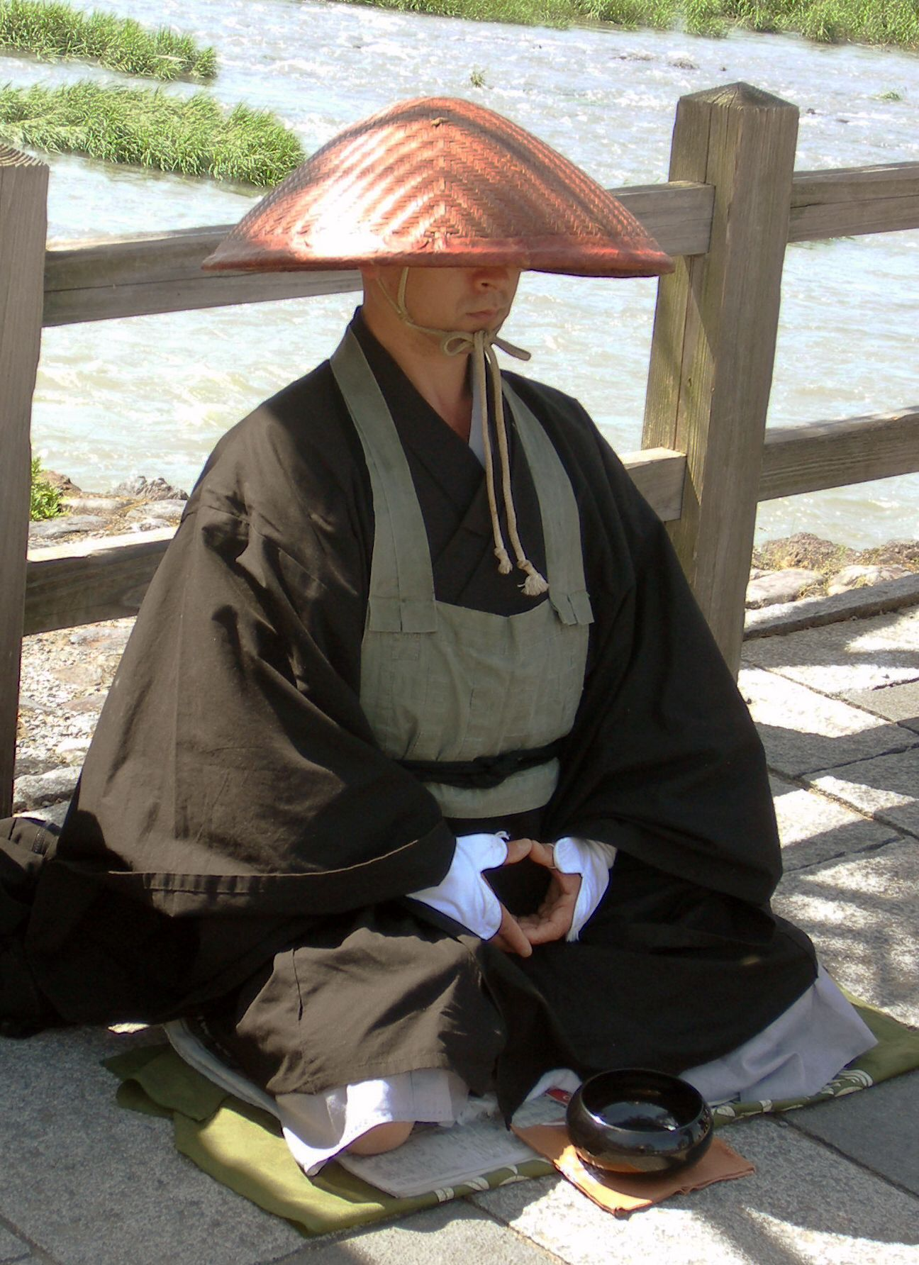 A rakusu is what is worn over the robe. A black one is worn by priest for special ceremonies