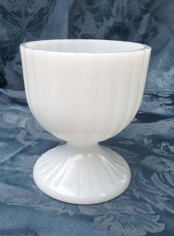 Hey, I found this really awesome Etsy listing at https://www.etsy.com/listing/155125325/vintage-white-ribbed-milk-glass-pedestal