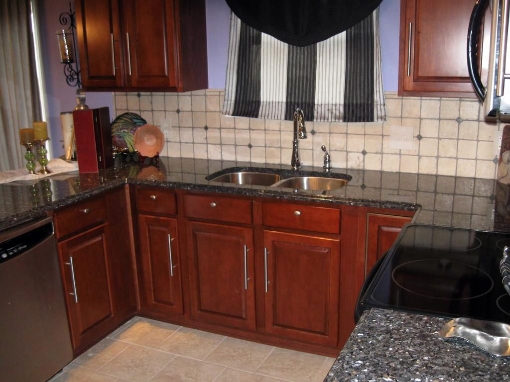 Elegant Kitchen Backsplash With Blue Pearl Granite Countertops   Google Search