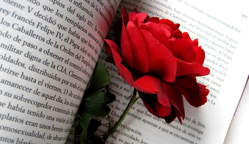 Why Barcelonians offer a book and a flower on St. George's day?