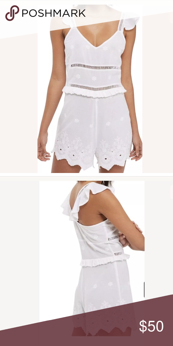 2d113a90caf4 Topshop White Ruffle Eyelet Ladder Broderie Romper A cotton romper stays  pretty and playful with ruffles