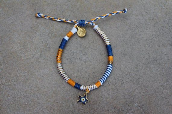 1 multicolor wrap bracelet with evil eye charmAdjustable from 15cmHas Burudiguru charm