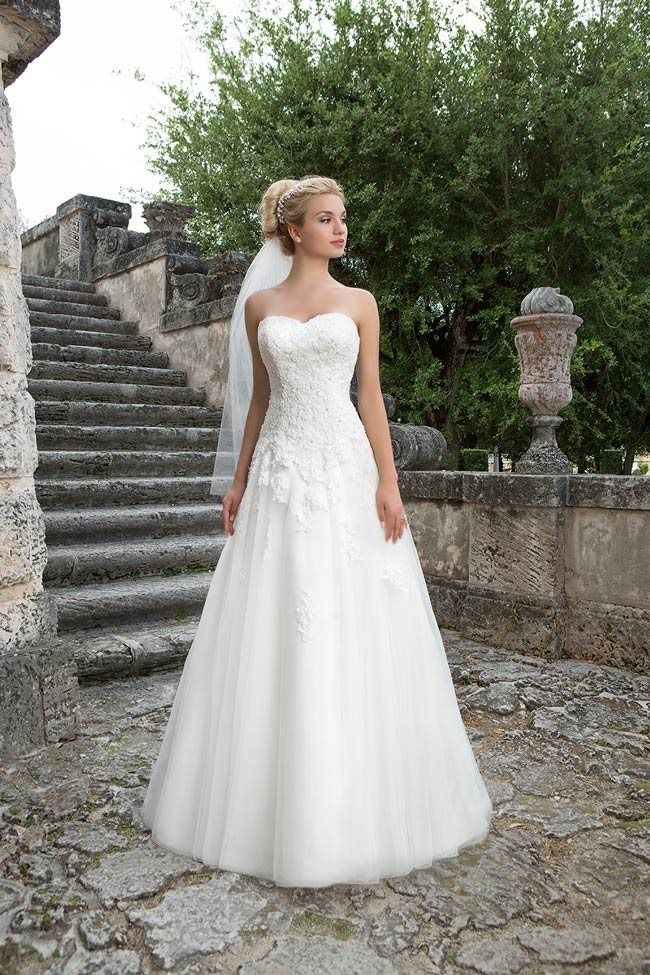 4d501ab79e9cf Style 3906 from Sincerity Bridal is a class A-line style with lace detailing