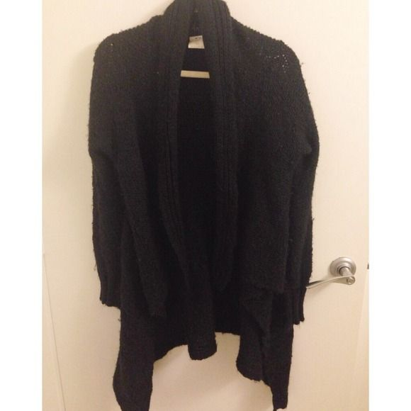 """Chunky black knitted sweater with draped front Chunky black knitted loose fit sweater with cable knit pattern in back and draped front. measures 30"""" at the longest (back side). Some piling as usual with these types of knitted sweaters. The """"holes"""" you might see in the last photo are part of the knit design and not flaws! Sweaters"""