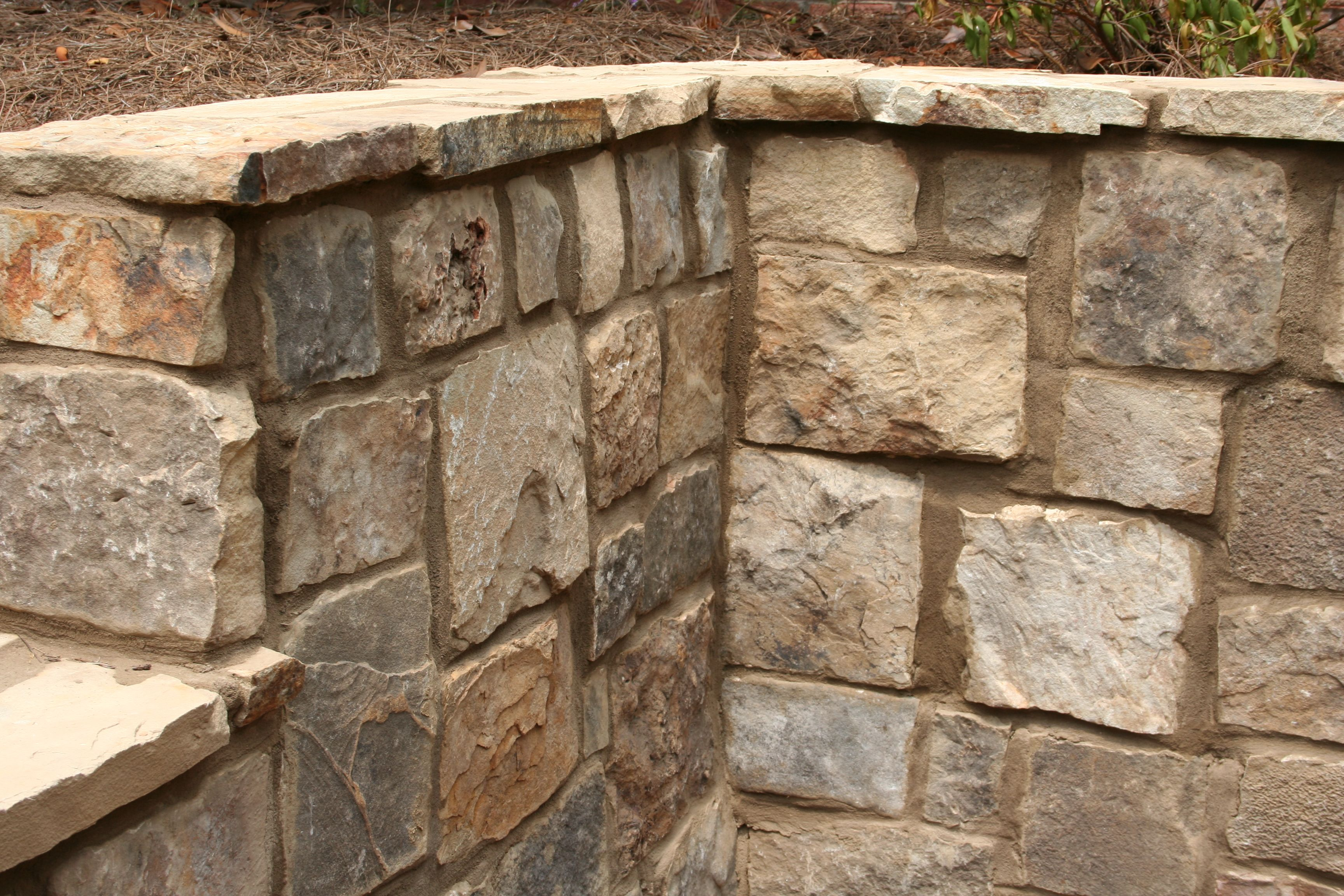 Tennessee ashlar fieldstone retaining wall. Crab Orchard cap ...