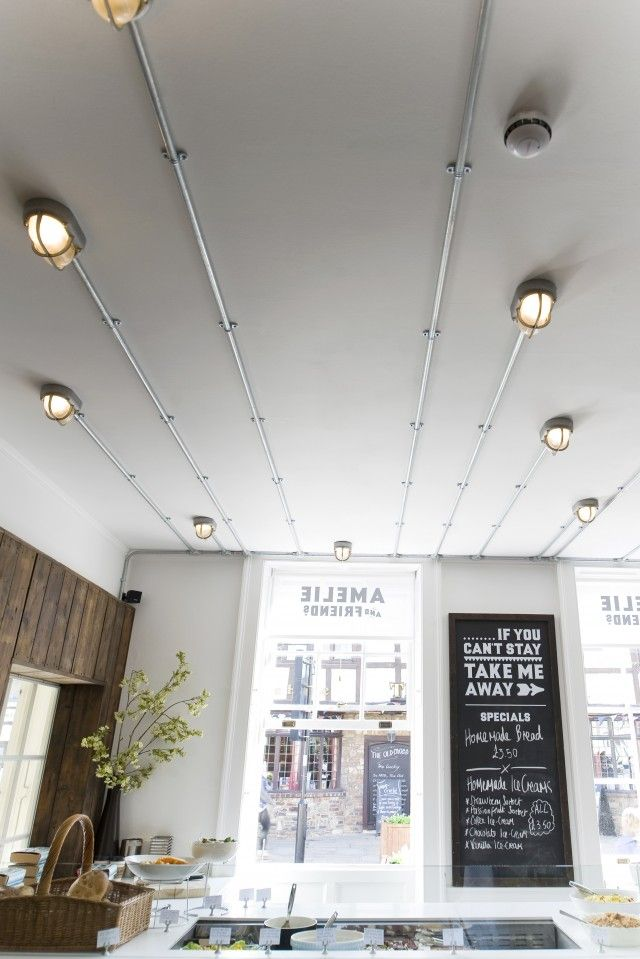 exposed lighting. amelie u0026 friends restaurant in chicester uk conduit lighting onto ceiling exposed d