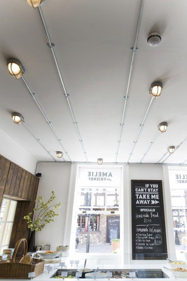 exposed lighting. amelie u0026 friends restaurant in chicester uk conduit lighting onto ceiling exposed d