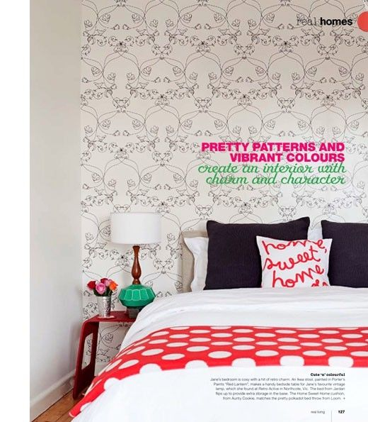 Bright coral polka dot bedding! matching typo cushion.