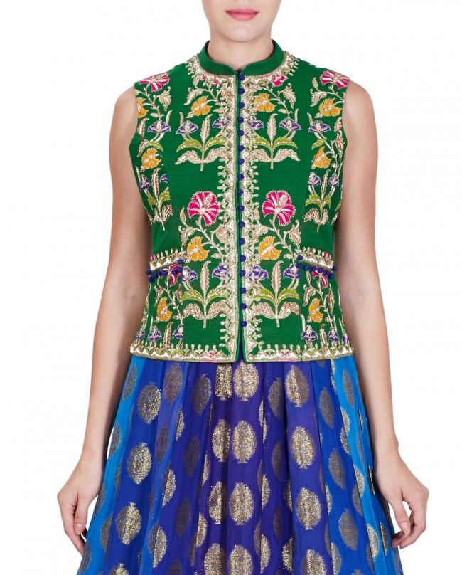 Blue anarkali kurta with golden motifs all over and a pleated frill hem. Green embroidered sleeveless jacket with blue potli buttons on the front and twin pockets. Wash Care: Dry clean only