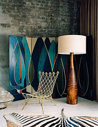 dream screen...fabu lamp.....amazing chair....exposed brick wall.....what's not to love......well maybe the zebra skin.....would have to be faux zebra!!