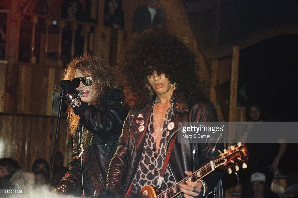 Axl Rose and Slash of the rock band 'Guns n' Roses' perform onstage at the Troubadour on the night that Tom Zutaut of Geffen Records was in attendance who would later sign them to a record deal on February 28, 1986 in Los Angeles, California. They also played the song 'Out Ta Get Me' for the first time that night.