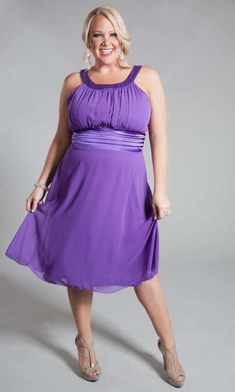 The name says it all. This exquisite plus size cocktail dress features beautiful caviarbeading along the neckline.Accentuate your curves with the satin pleated empire waist band. Features chiffon overlay and charmeuse shell. Invisible back zipper closure. Made in USA.