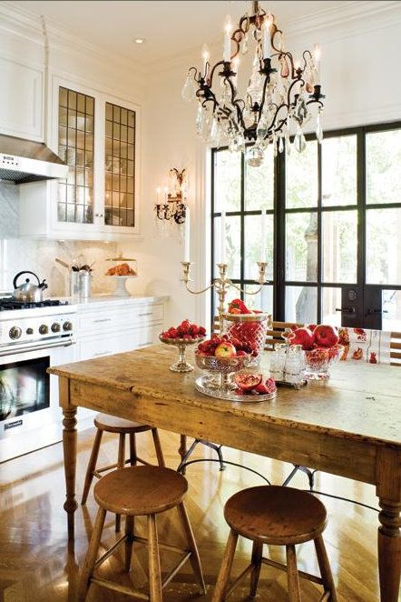 Love the repeating pattern on the cabinets and windows.  Beautiful light fixture.  Great table. Great view.