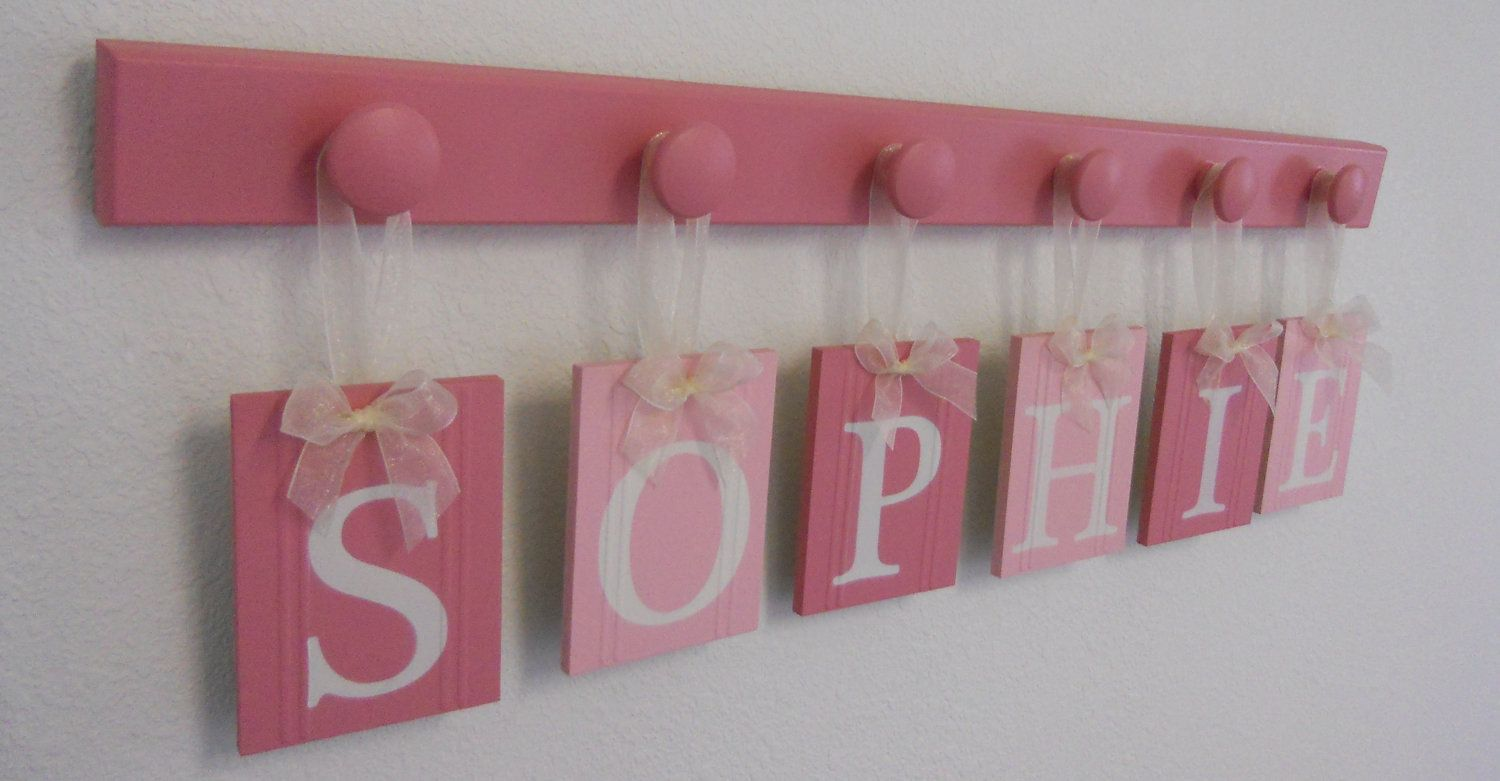 Personalized Children Name Signs for SOPHIE includes 6 Pegs Pink and Light Pink. $33.00, via Etsy.