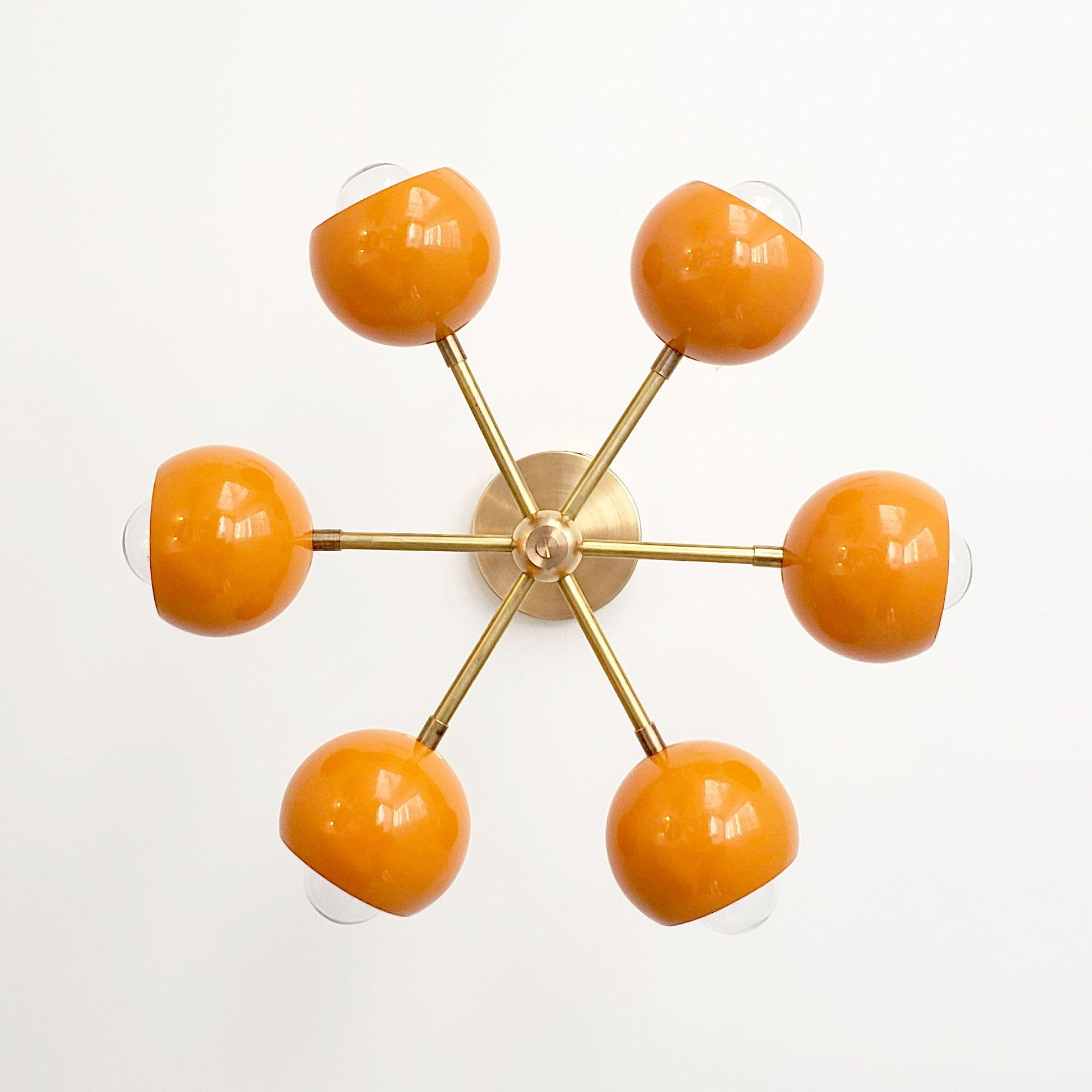 Photo of Orange and brass mid century modern ceiling lamp
