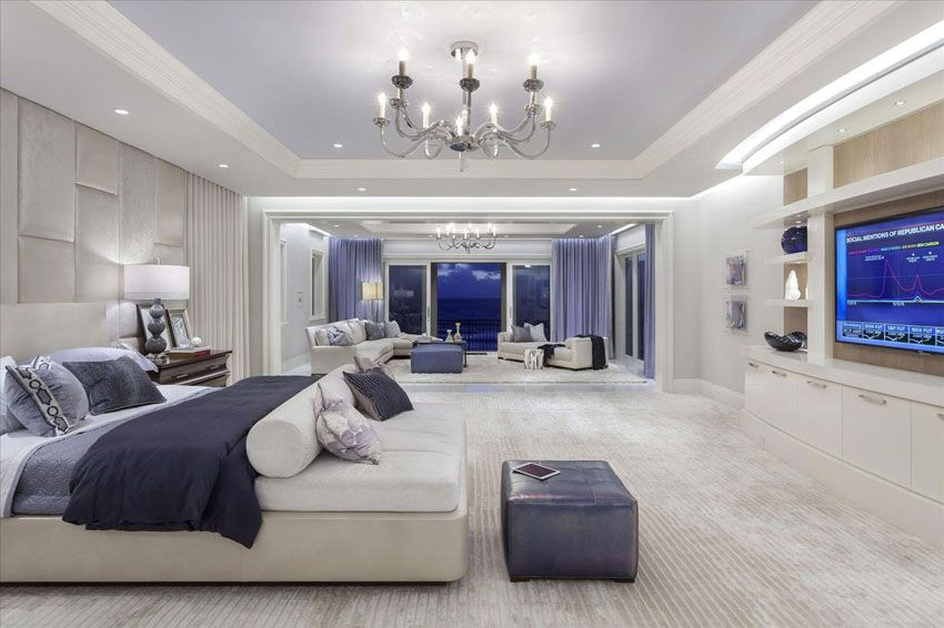 Contemporary Master Bedroom With Sitting Area, Tray Ceiling And Purple And  White Decor