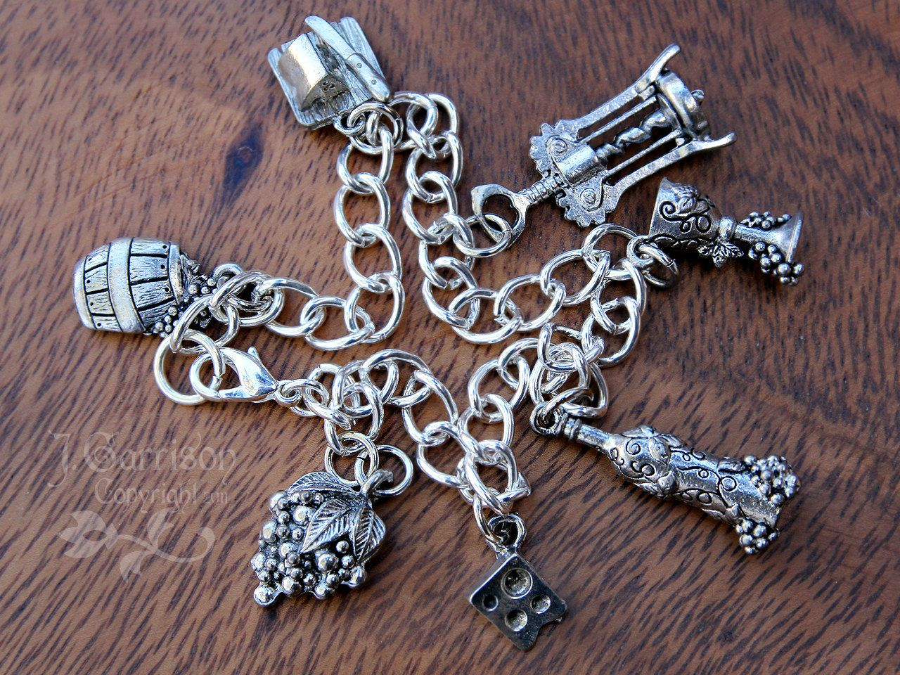 Wine & Cheese silver charm bracelet - cheese, wine, grapes, corkscrew, wine glass, barrel, bottle - on a chunky chain. $32.00, via Etsy.