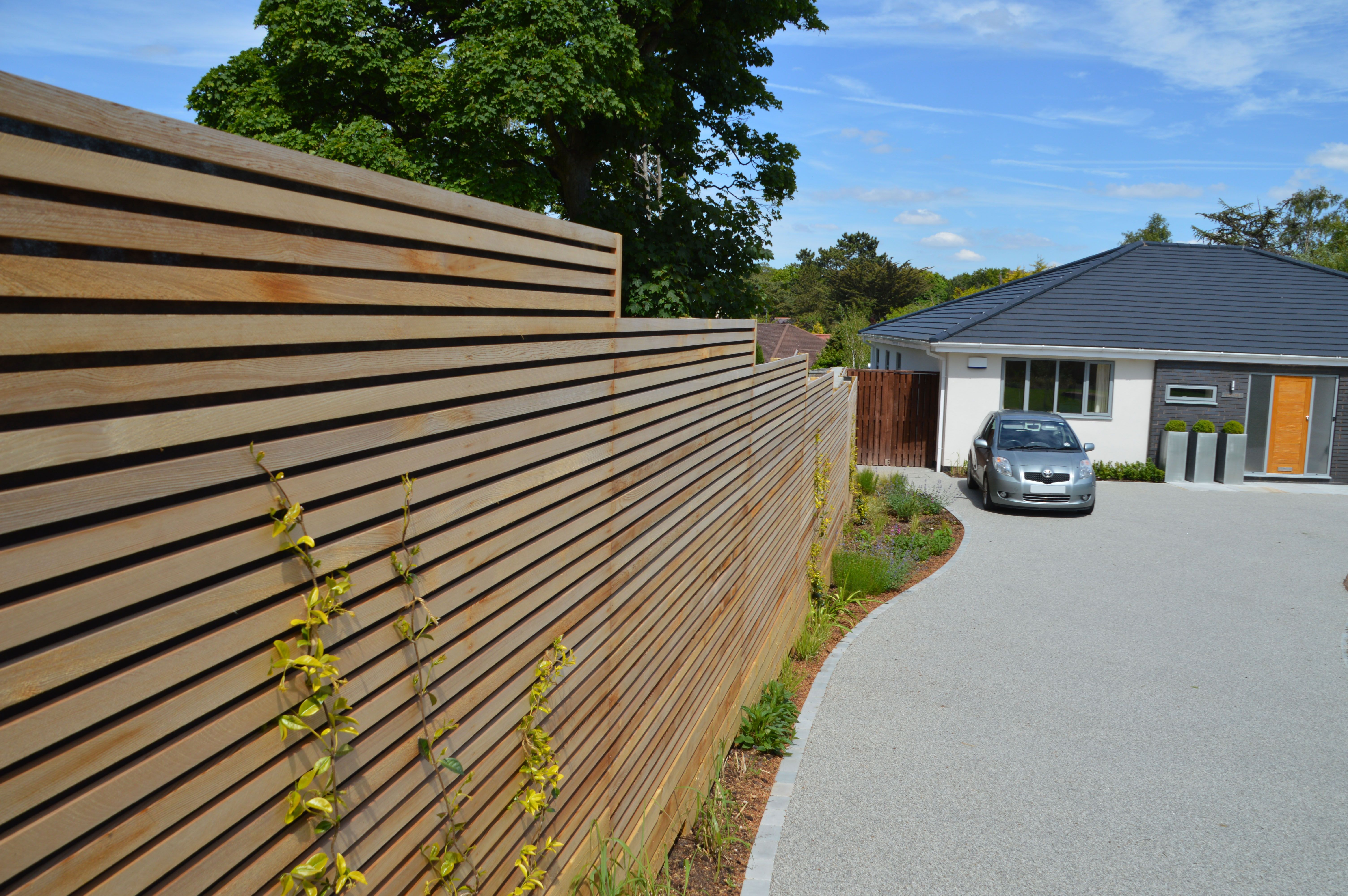 Slatted screens don t just belong in the garden they make an ultra