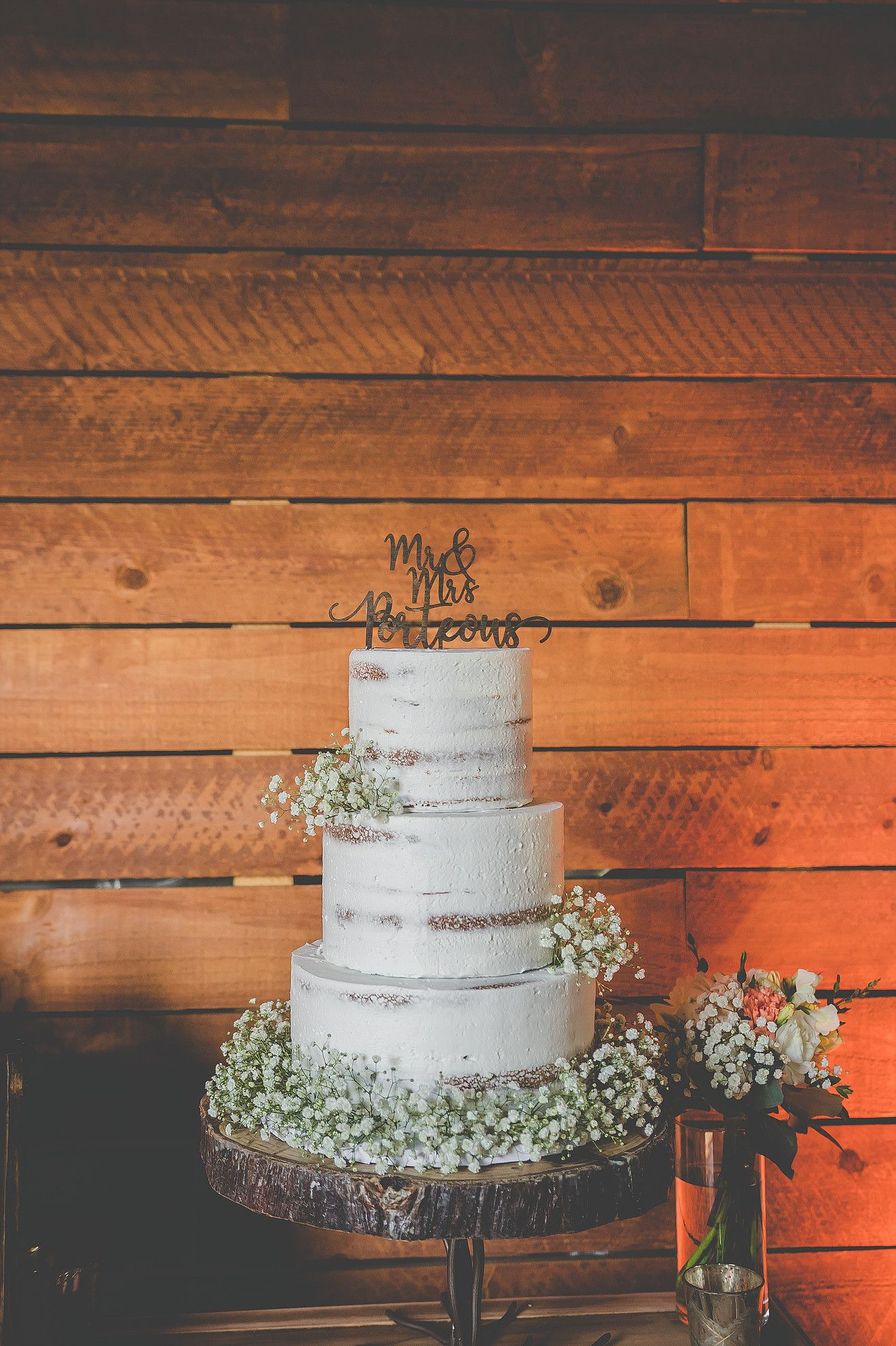 Bare wedding cake with babyus breath wooden cake topper cut wood
