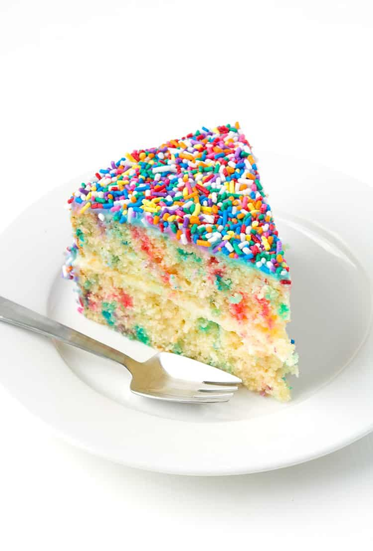 Funfetti Vanilla Layer Cake This Funfetti Vanilla Layer Cake is the perfect party cake! Filled with sprinkles and covered in vanilla buttercream, it's the softest and fluffiest cake I've ever had. Recipe from
